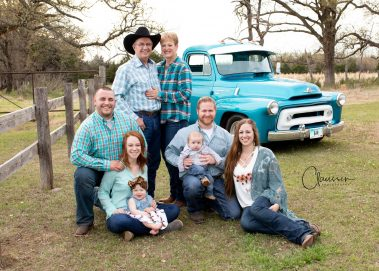 family photo with antique truck