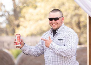 man pointing at beer